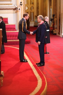 Stephen shaking hands with Prince William